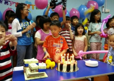 Singing the Birthday song for everyone.