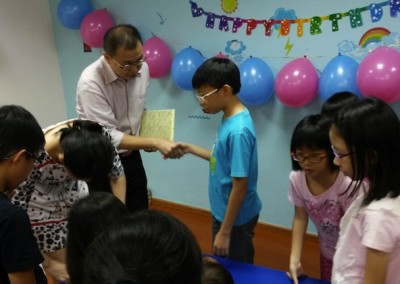 Mr. Julian Wan giving presents to our Birthday celebrants.