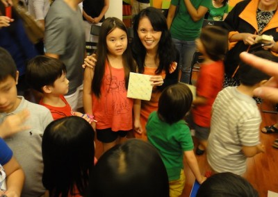 Cheryl Chia giving a gift to one of our celebrants.